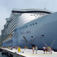 Marvel at the world's largest cruise ship. Oasis of the Seas towers over guests at the port of Labadee.