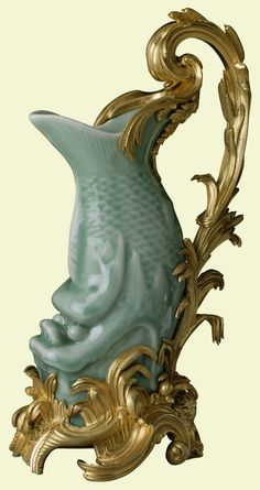 Chinese celadon vase, c.1740 (French mounts, c.1750-5)**.    Porcelain and gilt bronze    c.1740  The Royal Collection ©   These Chinese celadon vases, in the form of grotesque carp, were made in China in around 1740 and not long afterwards were mounted as ewers in France.     Probably purchased by George IV when Prince Regent #exoticflowersfrance