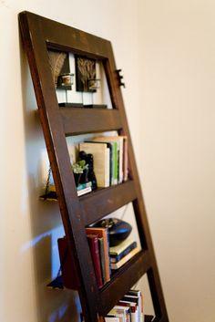 Vintage Door Repurposed Bookshelf. Only looks good on a hardwood floor. Dammit.