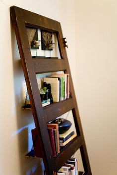 Vintage Door Repurposed Bookshelf. Only looks good on a hardwood floor. Dammit.