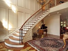 Traditional Staircase with Paintable white beadboard, Hardwood floors, High ceiling, Custom Wood Millwork & Wainscoting
