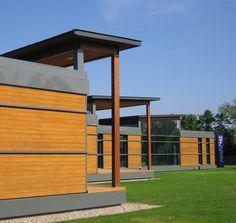 case in legno e erba