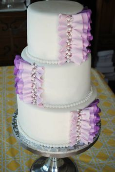 Purple wedding cake by Colie Cakes https://m.facebook.com/pages/Colie-Cakes/167911709929792?id=167911709929792&refsrc=http%3A%2F%2Fwww.google.ca%2F&_rdr