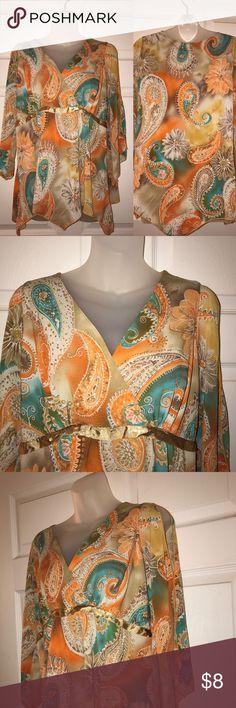 paisley dress top cute paisley design top, worn once, deep v cut neckline, peekaboo detail on shoulders Tops Blouses