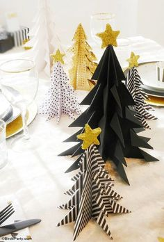 Origami is a fun activity which all ages can do. For kids, this activity is like playing. On the other hand, for the adults, making origami can be used as an ice-breaker or stress reliever after working hard. There are plenty of origami patterns which. Origami Christmas Tree, Paper Christmas Decorations, Christmas Tree Crafts, Christmas Tablescapes, Christmas Holidays, Simple Christmas, Christmas Stuff, Beautiful Christmas, Oragami Christmas Ornaments