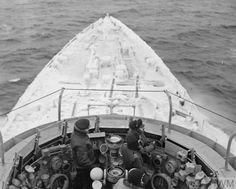 HMS BELFAST, open bridge in the Arctic conditions.