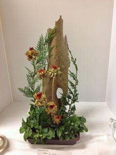 A creative design. #autumn #tree bark #flower arrangement  New Garden Club Journal