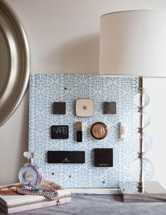 Adhere magnets to the back of your makeup compacts, and stick them on a metal board to save space while also decorating your walls. Unconventional Ways to Store Your Makeup - Beauty Product Organization - Cosmopolitan Cozy Dorm Room, Dorm Room Storage, Dorm Room Organization, Diy Storage, Storage Ideas, Smart Storage, Jewelry Storage, Storage Solutions, Makeup Storage Hacks