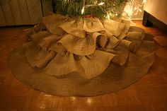 My easy to make DIY Burlap Ruffle Christmas Tree Skirt. Check it out on my blog for what materialsyou will need and advice :)