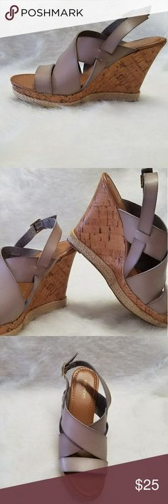 Grey wedge sandals These have never been worn.  They are a size 8 , but fit like a 7.5 . They have a cork heel which makes them super comfortable and beautiful. The bottom is edged with a rope border. Maurices Shoes Wedges