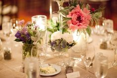 mixed flowers in simple glass vases, fresh and airy for a casual feel