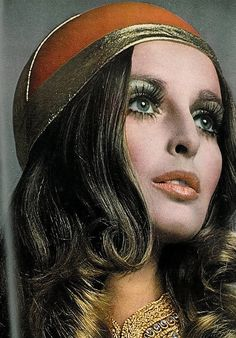 Blue eye shadow, defined lashes, and a soft coral lip were popular in the 70's. It was a part of the 70's boho, hippie street style.