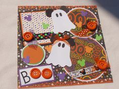 Boo!...Bright, Colorful, and Fun page for all of your Halloween memories!....includes three photo mats and a great spot for