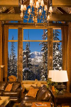 Gorgeous Great room in a Mountain Home with amazing windows to enjoy the view!