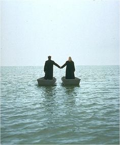 Geof Kern. It looks to me like a slab-serif M. I would like to see the entire alphabet of two people in boats.