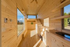 A new Japanese-inspired tiny house with a warm, minimal interior from Escape Traveler Homes.