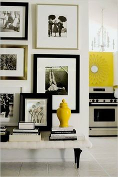 --overlap picture frames on wall so that some stick out Chic Gallery Wall with lovely bench stacked with books.great idea for an entryway or Hallway or focal wall in living room. Estilo Interior, Home Interior, Interior Decorating, Yellow Interior, Bathroom Interior, Modern Bathroom, Decoration Inspiration, Interior Inspiration, Decor Ideas