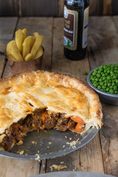 British Steak and Ale Pie is a classic dish found in most pubs around England. Tender pieces of steak are cooked with vegetables and English ale, then wrapped in a flaky buttery crust. Serve it with pea and chips for a perfectly comforting meal. Steak Pie Recipe, Steak Ale Pie, Steak And Ale, Beef And Ale Pie, Curry Recipes, Meat Recipes, Food Processor Recipes, Cooking Recipes, Recipies