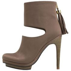 """This dramatic bootie from designer Silvia Tcherassi features a shiny satin upper with chic almond toe, cool cut-out at the front of the ankle, modern back zipper with tassel detail, soft jersey lining and padded insole for comfort, and a 4.5"""" heel with platform. Fabric and manmade materials"""