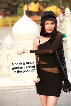 """""""A book is like a garden carried in the pocket""""."""