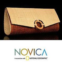 By Carlos Paiva, this stylish clutch handbag showcases the natural fibers of Brazil. Crafted of handwoven buriti palm, the chic clutch handbag features a decorative ring of jatoba wood on the flap.