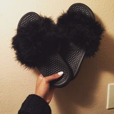 Black furry Nike slides Multiple sizes available When making an offer keep in mind the slides themselves are  nearly 30 after tax Nike Shoes Sandals