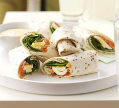 Salmon & egg wraps with mustard mayo: Mix some mayonnaise, mustard and minced onion, spread on Tortilla. add 2 slices of smoked salmon, some sliced hard-boiled egg and a generous helping of spinach to each.