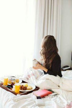 Delicious Breakfast In Bed With Fresh Orange Juice And Fruit Bowls