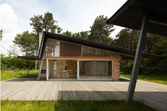 If It's Hip, It's Here: Denmark Home For Architect Jesper Brask Is Made From 150 Local Trees and Kolumbia Tiles.