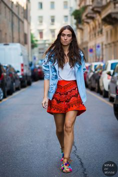 Printed mini skirt and pom pom sandals.