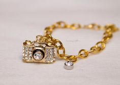 Check out this item in my Etsy shop https://www.etsy.com/listing/179246222/gold-crystal-chic-camera-charm-bracelet