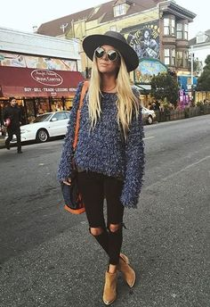 textured navy sweater with black ripped jeans