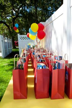 "The goody bags at this party were filled with hero favors! From Spiderman crayons, to ""Superman's Kryptonite"" (green noise putty)! #events #birthday #superhero #favors"