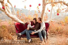 Outdoor Family Christmas Photo with a Red Couch