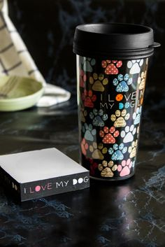 "The perfect pair for dog lovers! Pour a hot cup of coffee and get started on your to-do list with this darling duo, covered in paw prints and bearing the words, ""I love my dog, my dog loves me."" Just the inspiration you need to complete the task at hand!"