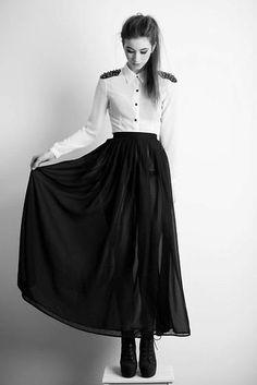 Studded shirt and long black skirt.