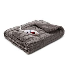 $62.99 Soothing and portable, the Biddeford Extra Long Microplush Heated Throw is the best way to relax. This comfy heated blanket has 6 heat settings so you can choose the level that suits your comfort. The microplush 100% polyester fabric feels soft on your skin. It's a great throw to have on hand for those winter days when you need a little extra warmth.