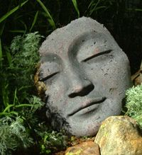 I've always been drawn to moon pie faces... which leads to these type of faces. I've made jewelry before with cuts outs similar to this. But how great it would be to have one of these perched in my Zen Bamboo Garden.