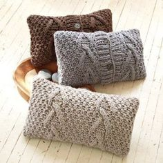 upcycled sweaters make tactile toss pillows for the autumn/winter