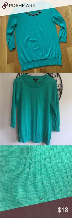 J. Crew merino wool sweater J. Crew sweater in super-soft merino wool with 3/4 length sleeves. The color is a lovely jade green (represents best in second photo). There are two tiny holes on the upper back, priced accordingly. Worn twice! J. Crew Sweaters Crew & Scoop Necks