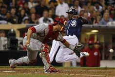 Game #86 7/7/12: San Diego Padres' Cameron Maybin is airborne as he beats the throw home to Cincinnati Reds catcher Devin Mesoraco while scoring in the fifth inning of a baseball game, Saturday, July 7, 2012, in San Diego. Maybin scored on a single by Logan Forsythe. (AP Photo/Lenny Ignelzi)