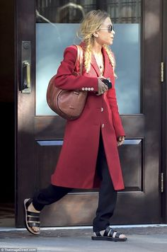 Simply chic:Mary-Kate Olsen put on a colourful show in a bright red overcoat when she left The Greenwich Hotel in the Tribeca neighbourhood of New York on Wednesday afternoon