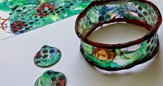 Trying new ways to use this deli paper. Bracelet made by wrapping paper around glass tumbler sized for wrist--hot glue adde. Plastic Jewelry, Diy Jewelry, Handmade Jewelry, Jewelry Making, Jewelry Ideas, Jewlery, Jewelry Box, Make Paper Beads, Bangle Bracelets