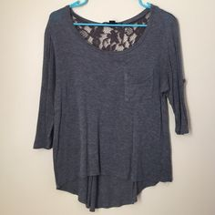 lace back 3/4 top gently worn. high low, lightweight, perfect for spring! Forever 21 Tops