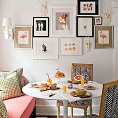 Picture Perfect: Hang a Wall Collage. All of this is very pretty to me. I like the collage of art prints, although I think they are too close together and feel cramped. I think the zebra chevron striped chairs work well in this nook though