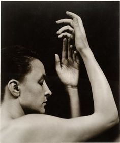 stieglitz portrait of o'keefe (his fascination for her hands is shown in his photographs often.)
