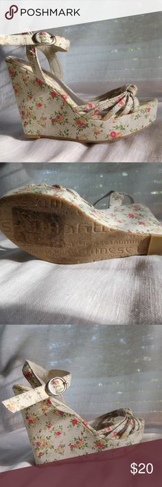 Floral Print Wedge Sandal The floral print fabric has a cream base with pastel flowers. Made by Chinese Laundry, these wedge sandals have a 1.5 inch platform and a 5 inch heel. Chinese Laundry Shoes Wedges