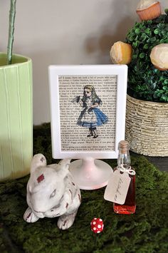 Alice in Wonderland party - Different characters as table numbers? -- print over old dictionary pages and frame