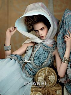 Cara Delevingne photographed by Karl Lagerfeld for Chanel's Cruise/Resort 2013 ad campaign.