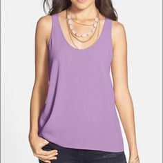 HP Frenchi Lilac Racerback Swing Tank Beautiful Frenchi lilac racerback swing tank. Night lightweight silky material, flowy silhouette and racerback. Size medium, but runs a bit smaller. Gorgeous tank and beautiful color for summer! Excellent condition. Brand is Frenchi, listed under Nasty Gal for exposure. Nasty Gal Tops Tank Tops